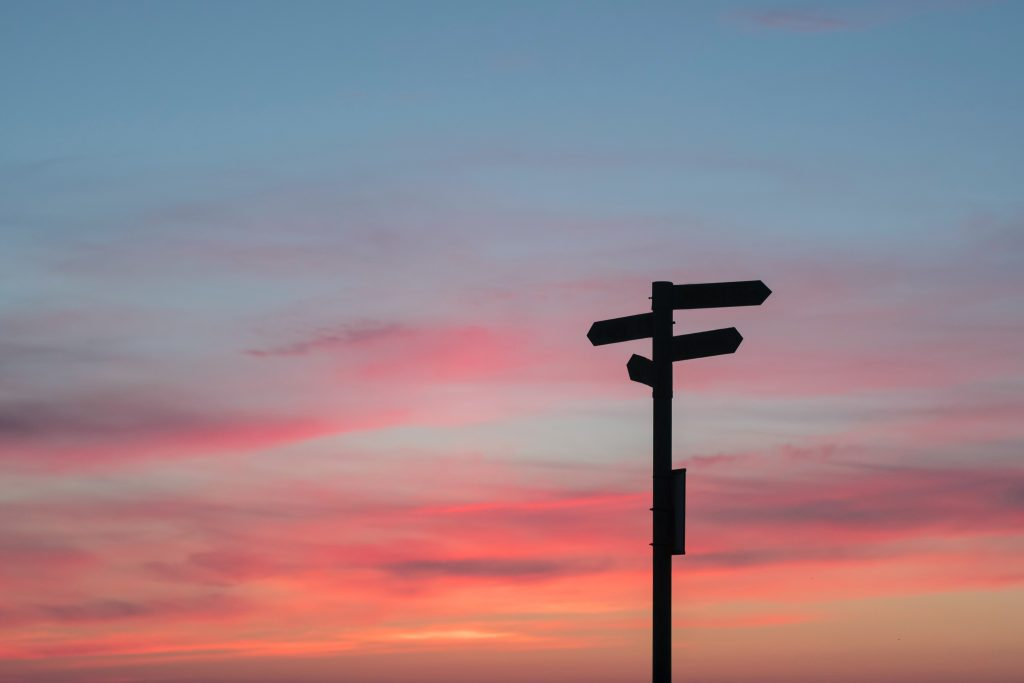 directional sign at sunset